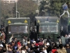 Egypt Protesters jumping over cars