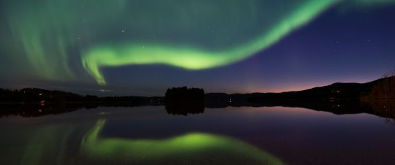 TOPSHOT - The Aurora Borealis or Northern Lights illuminate the night sky on August 23, 2016 in Erikslund village at Vaesternorrland County in Sweden. / AFP / JONATHAN NACKSTRAND (Photo credit should read JONATHAN NACKSTRAND/AFP/Getty Images)